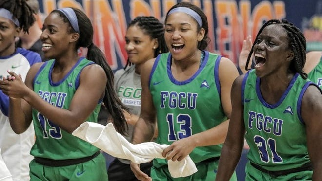 FGCU players celebrate as their team upset Notre Dame on Thanksgiving Day.