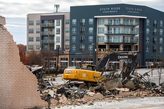A demolition crew razed the old Cobb Tire building at the corner of University Ridge and Church Street Friday, November 29, 2019, making way for the redevelopment of County Square as a $1 billion mixed-use neighborhood of apartment complexes, office buildings and retail.