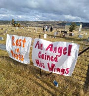 Mourners hung banners in remembrance of Tony Renova at the Crow Indian Reservation cemetery where the five-year-old was buried.