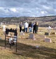Tony Renova's foster family pays their final respects at the five-year-old's grave site.