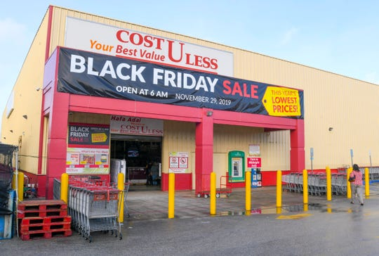 A huge Black Friday banner welcomes shoppers to the Cost-U-Less store in Tamuning in this Nov. 29, 2019, file photo.