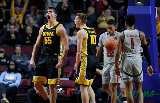 Iowa's Luka Garza (55) reacts after scoring against Texas Tech during the first half of an NCAA college basketball game Thursday in Las Vegas.