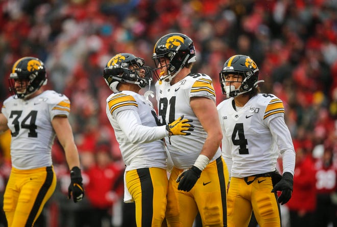 Iowa's Geno Stone and Brady Reiff (91) celebrate after Reiff tackled Nebraska quarterback Adrian Martinez in the first quarter during their Big 10 final season game on Friday, Nov. 29, 2019, at Memorial Stadium in Lincoln, Neb.