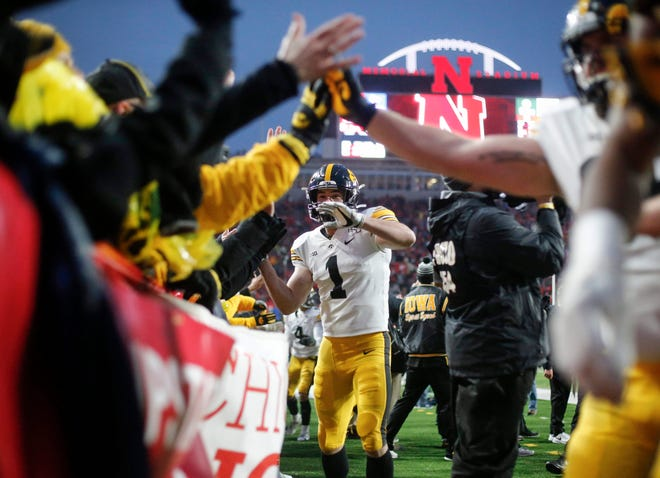 Iowa senior defensive back Wes Dvorak celebrates with fans after the Hawkeyes beat Nebraska on Friday, Nov. 29, 2019, at Memorial Stadium in Lincoln, Neb.