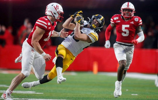 Iowa freshman receiver Nico Ragaini briefly pulls in a pass against Nebraska in the fourth quarter during their Big 10 final season game on Friday, Nov. 29, 2019, at Memorial Stadium in Lincoln, Neb. The catch was later overturned and ruled incomplete after a game official reviewed the play.