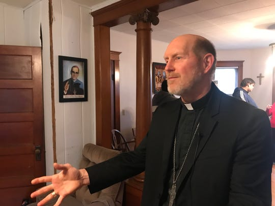 Bishop Thomas Zinkula talks about immigration challenges following a round table discussion at the Iowa City Catholic Worker House Nov. 27, 2019.