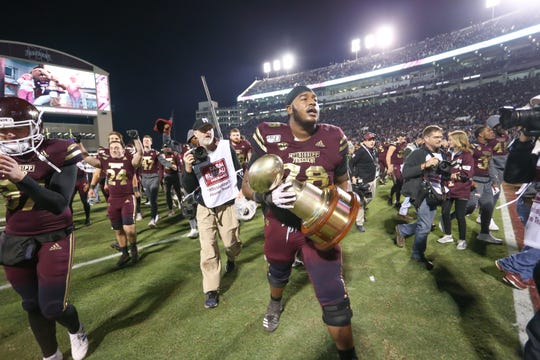 Mississippi State's Tyre Phillips (78). MSU players celebrate after winning the Egg Bowl 21-20. Mississippi State and Ole Miss played in the Egg Bowl on Thursday, November 28, 2019 at Davis Wade Stadium in Starkville.