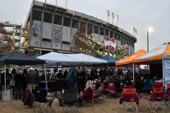 Fans tailgate before the game between the Mississippi State Bulldogs and the Mississippi Rebels at Davis Wade Stadium.
