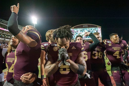 After Davis Wade Stadium stadium rose in one voice singing Hail State, Bulldog Kylin Hill pauses in silent thanks. MSU beat Ole Miss in the Egg Bowl with a score of 21-20. Thursday, Nov. 28, 2019.