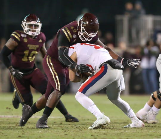 Mississippi State's Marquiss Spencer (42) tackles Ole Miss's John Rhys Plumlee (10). Mississippi State and Ole Miss played in the Egg Bowl on Thursday, November 28, 2019 at Davis Wade Stadium in Starkville.