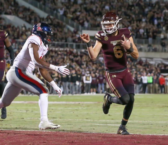 Mississippi State's Garrett Shrader (6) scores a touchdown to give MSU a 14-0 lead in the second quarter. Mississippi State and Ole Miss played in the Egg Bowl on Thursday, November 28, 2019 at Davis Wade Stadium in Starkville.