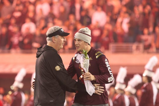 Mississippi State head football coach Joe Moorhead talks to Mississippi State's Tommy Stevens (7) during Senior Night ceremonies. Mississippi State and Ole Miss played in the Egg Bowl on Thursday, November 28, 2019 at Davis Wade Stadium in Starkville.
