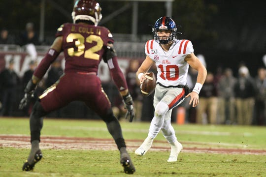 Mississippi Rebels quarterback John Rhys Plumlee (10) runs the ball while defended by Mississippi State safety Brian Cole II (32) during the second quarter at Davis Wade Stadium.