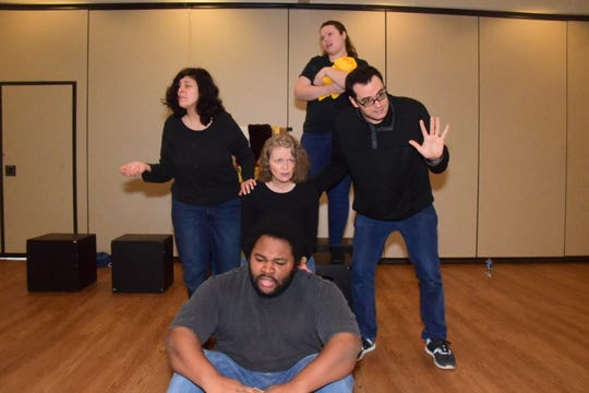 Pictured front Joseph Brown; back Amy Minolfo, Jeni Lamm, Glory Ledbetter, and Stavros Keritsis create a living tableau from the story of a special needs child at Karns Senior Center Thursday, Nov. 21.