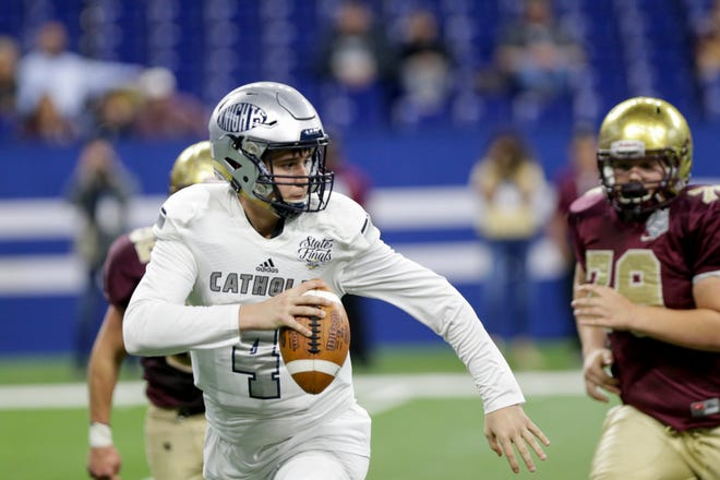 Central Catholic's Clark Barrett (4) is pressured during the second quarter of the IHSAA class A football championship, Friday, Nov. 29, 2019 at Lucas Oil Stadium in Indianapolis.