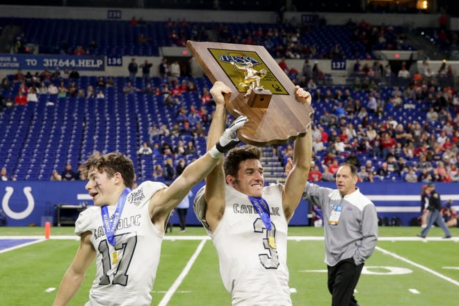 Central Catholic's Isaac Switzer (17) and Central Catholic's Reece Buche (3) celebrates celebrate after defeating Lutheran, 29-28, to win the IHSAA class A football championship, Friday, Nov. 29, 2019 at Lucas Oil Stadium in Indianapolis.