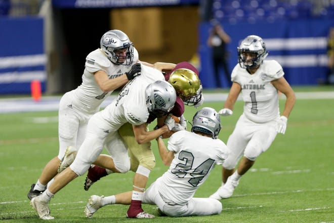 Central Catholic's Kyle Onken (7), Central Catholic's Tommy Regich (31) and Central Catholic's Tommy Puskar (24) stop Lutheran's Montasi Clay (2) during the second quarter of the IHSAA class A football championship, Friday, Nov. 29, 2019 at Lucas Oil Stadium in Indianapolis.
