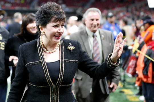 New Orleans Saints owner Gayle Benson waves to the crowd before the first half of an NFL football game between the Atlanta Falcons and the New Orleans Saints, Thursday, Nov. 28, 2019, in Atlanta. (AP Photo/John Bazemore)