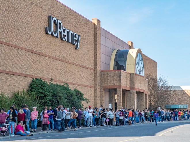Some local businesses are closing in the wake of the pandemic, including JC Penny, shown here as people lined up for Black Friday shopping.