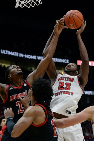 Western Kentucky's sophomore center, Charles Bassey had some good moments in his team's overtime win over Arkansas, but unfortunately he ended up suffering a knee injury late in the game.  (Photo: Mark Zaleski/Associated Press via Courier Journal.)