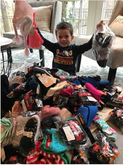 Sam Donohue, 5, started a sock drive for needy kids that ended up with nearly 600 donated pairs.