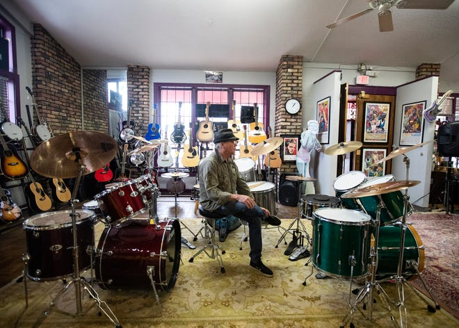 Evan Leake, who has managed Consignment Music Store for 10 years, sits in front of a drum set in Memphis, Tenn., on Friday, Nov. 29 2019.
