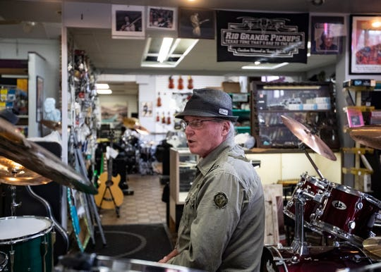 Evan Leake, who has managed Consignment Music store for 10 years, sits in front of a drum set in Memphis, Tenn., on Friday, Nov. 29, 2019.