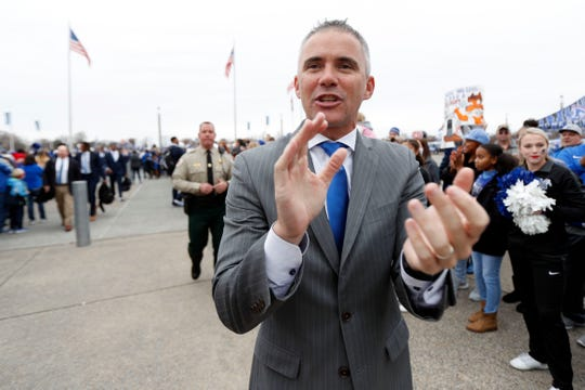 Head coach Mike Norvell leads the team on the Tiger Walk on Friday, Nov. 29, 2019, before a game against Cincinnati at Liberty Bowl Memorial Stadium in Memphis.