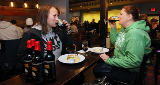 Jean Bisek, left, and Jan Byal, from West Allis, enjoy Milwaukee County Stout beer  while having breakfast at the Explorium Brewpub. Last year, the friends were the first in line. This year they had to settle for third. A crowd of about 200 lined up to purchase the once a year beer that is priced at $16.