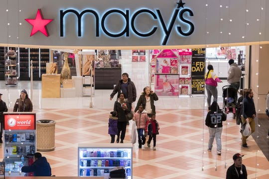 Shoppers exit Macy's at Mayfair Mall in Wauwatosa on Thursday. The mall and about half the stores were open Thanksgiving Day from 6 p.m. until midnight. The mall is open Friday 6 a.m. to 10 p.m.