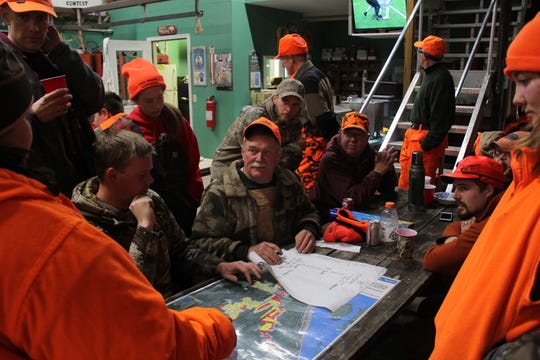 Mark Noll, center, plans a deer drive on Nov. 24 at his family's deer camp in Alma. All members of the camp use copper bullets to avoid potential poisoning of bald eagles and other wildlife caused by lead ammunition.
