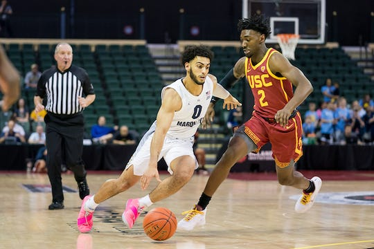 Marquette's Markus Howard drives to the basket against USC on Friday. Howard scored 51 points and has 91 points the first two days of the tournament.
