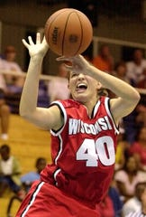 2001: Wisconsin's Shawna Nicols shoots during a game against Florida at the Paradise Jam basketball tournament at the University of Virgin Islands in St. Thomas, U.S. Virgin Islands. (Wisconsin won 61-49 taking third place in the tournament.)