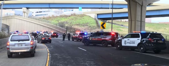 Numerous squad cars respond to a crash  on an I-43 ramp at the Marquette Interchange.