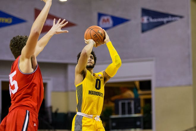 Marquette's Markus Howard puts up a shot against Davidson on Thursday at the Orlando Invitational.