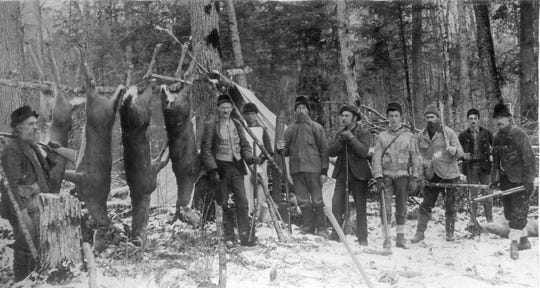1896: A hunting scene near Perry Swan's sawmill in the town of Frankfort, Marathon County. Perry Swan is shown at the extreme left with a gun over his shoulder. Left to right: Perry Swan, J.J. Shaw, Peter Kyle, Wm. Stead, A.W. Swan, G. Gebhardt, Richard Badtke, Wm. Laramie, John Smith.