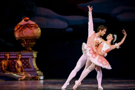 """Parker Brasser-Vos and Alana Griffith dance in Milwaukee Ballet's """"The Nutcracker."""" Both are former members of MBII, Milwaukee Ballet's training program for young dancers."""