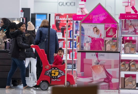 Shoppers peruse Macy's on Thursday at Mayfair Mall in Wauwatosa.