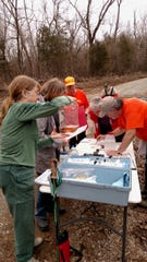 Master Naturalists test Pigeon Creek stream water for phosphates and nitrates, as well as acidity/alkalinity, turbidity and oxygen concentration.