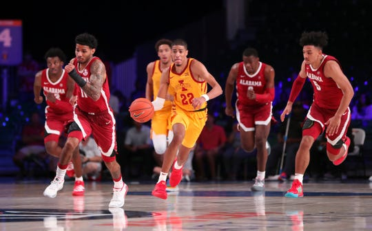 Iowa State guard Tyrese Haliburton (22) dribbles away from the Alabama defense on Nov. 28, 2019, in Nassau, Bahamas.