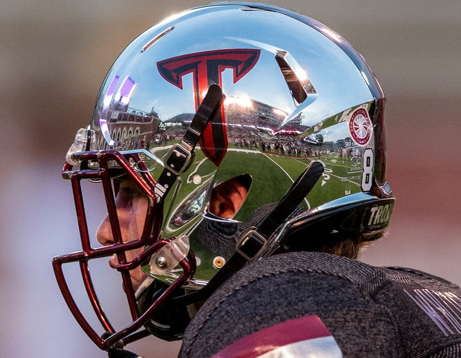 The stadium is reflected in the helmet of Troy wide receiver Luke Whittemore (83) as the team warms up before the Appalachian State game on the Troy campus in Troy, Ala., on Friday, November 29, 2019.