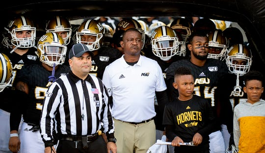Alabama State head coach Donald Hill-Eley and his team wait to take the field before the Turkey Day Classic on the ASU campus in Montgomery, Ala., on Thanksgiving Day, Thursday, November 28, 2019.
