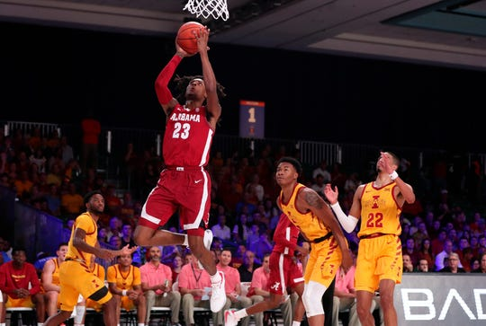 Nov 28, 2019; Nassau, BHS; Alabama Crimson Tide guard John Petty Jr. (23) shoots  during the first half against the Iowa State Cyclones at Imperial Arena. Mandatory Credit: Kevin Jairaj-USA TODAY Sports