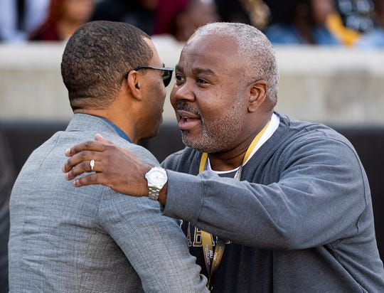 Montgomery Mayor Steven Reed hugs Alabama State University President Quinton Ross, Jr., at the Turkey Day Classic on the ASU campus in Montgomery, Ala., on Thanksgiving Day, Thursday, November 28, 2019.