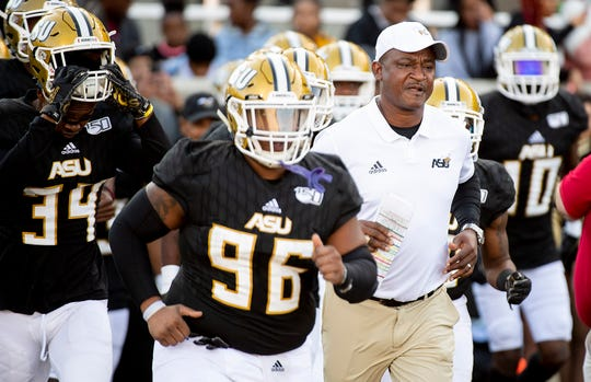Alabama State head coach Donald Hill-Eley takes the field with his team before the Turkey Day Classic on the ASU campus in Montgomery, Ala., on Thanksgiving Day, Thursday, November 28, 2019.