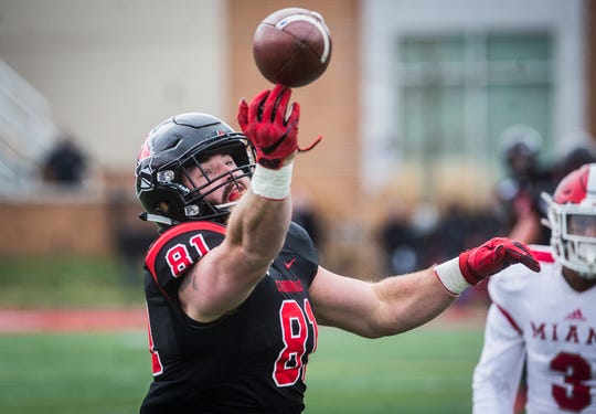 Ball State's Kyle Schrank catches a pass against Miami of Ohio's defense during their game at Scheumann Stadium Friday, Nov. 29, 2019.