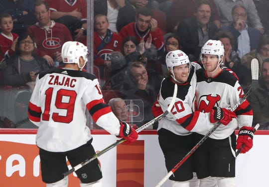 Nov 28, 2019; Montreal, Quebec, CAN; New Jersey Devils defenseman Damon Severson (28) celebrates his goal against Montreal Canadiens with teammates center Blake Coleman (20) and center Travis Zajac (19) during the third period at Bell Centre. Mandatory Credit: Jean-Yves Ahern-USA TODAY Sports