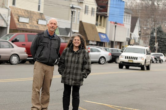 Sandy Liss and Fred Shafer stand amid parking spaces on Main Street in Butler, N.J.