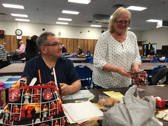 David and Barbara Pinto prepare for a night of bingo at Boys and Girls Club of Clifton.