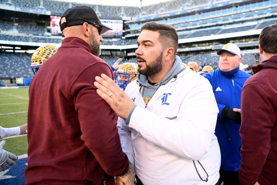 Lyndhurst head coach Rich Tuero, right, and his team lost to Verona, 41-0, in the North Group 2 championship on Friday, Nov. 29, 2019, in East Rutherford.